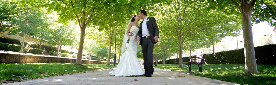Bride and Groom walking and kissing